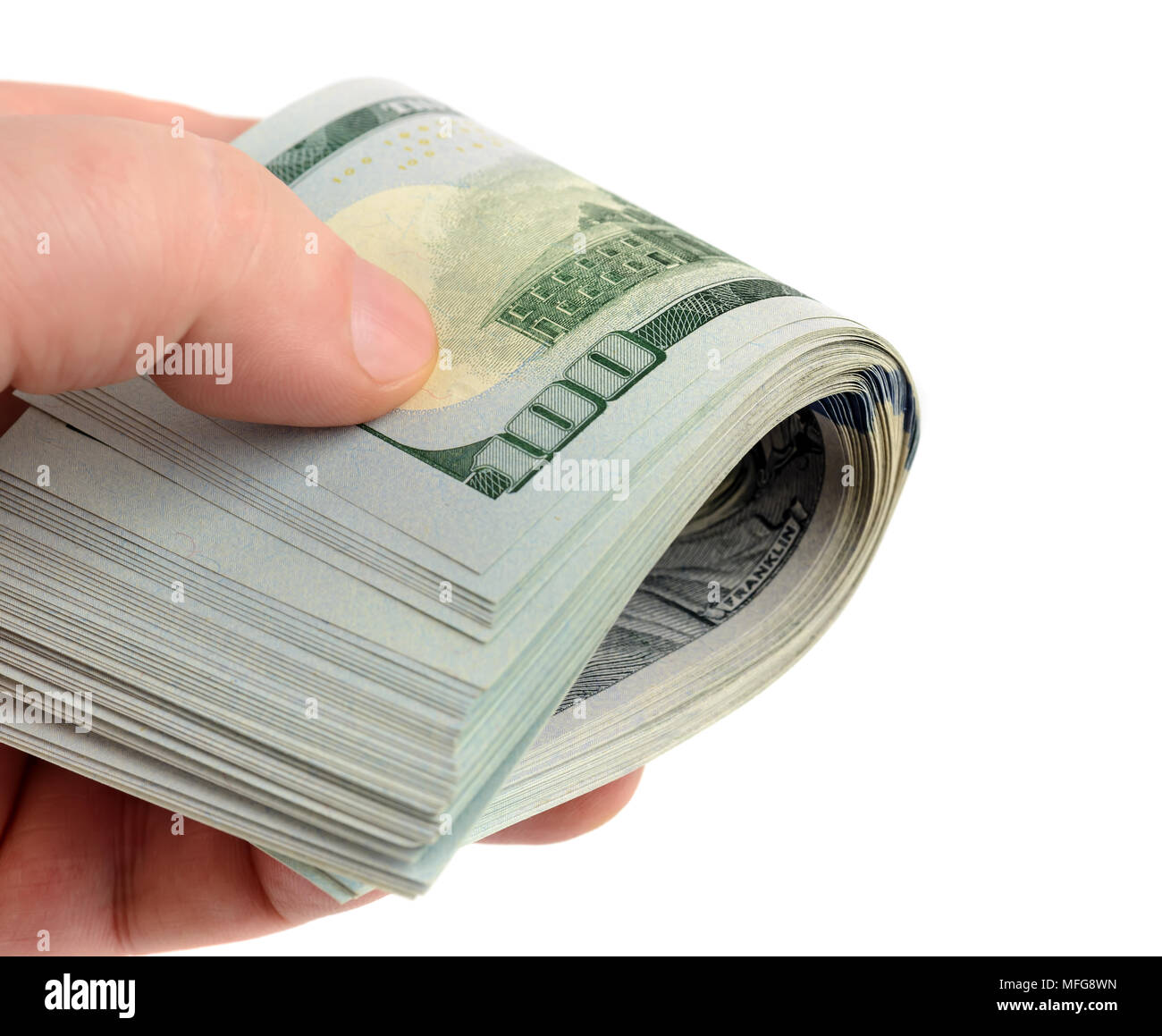 La main avec beaucoup de dollars dans roll isolated on white Photo Stock