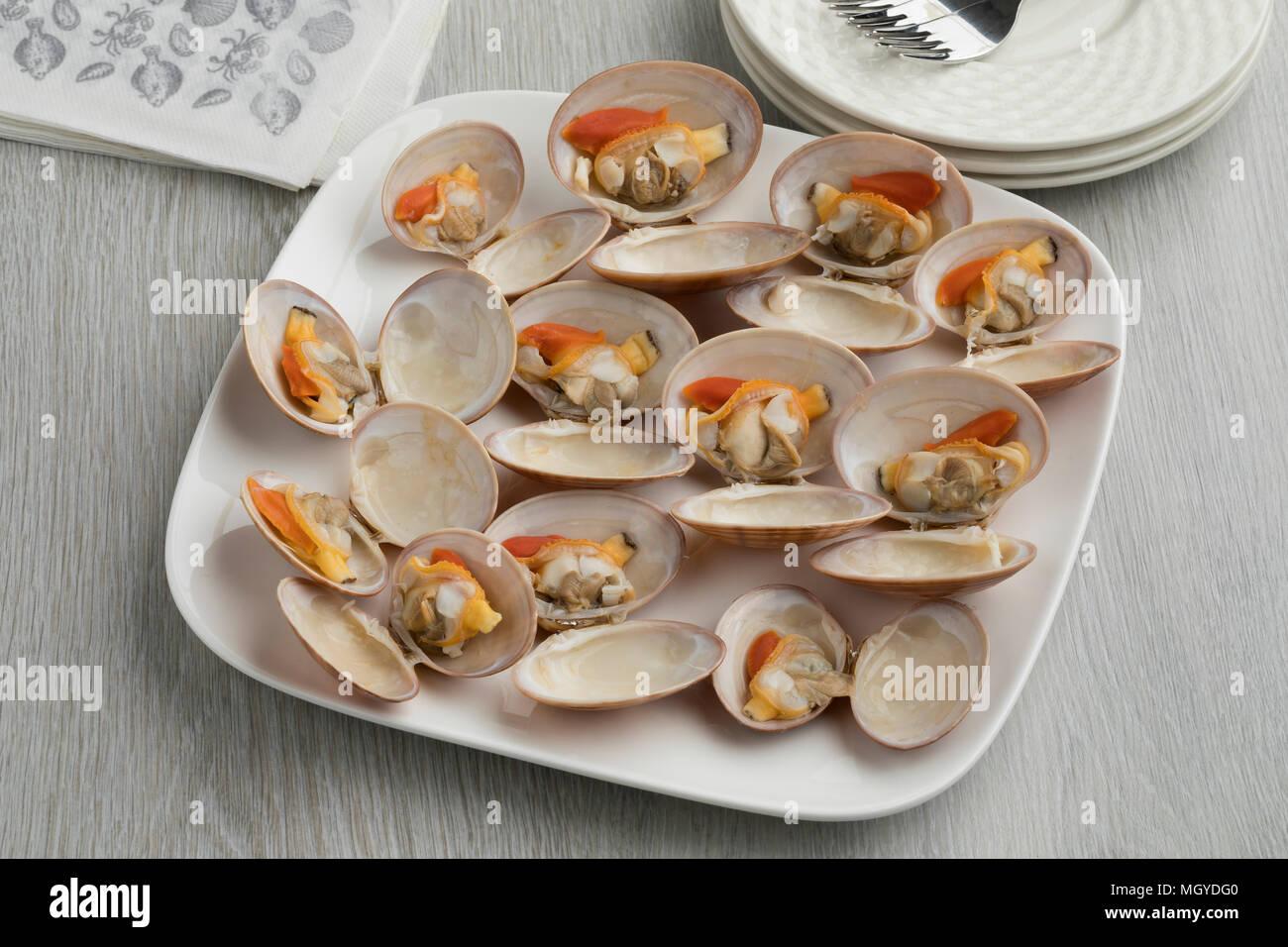 Plat d'ouvrir les palourdes cuites bon comme un gourmet Photo Stock