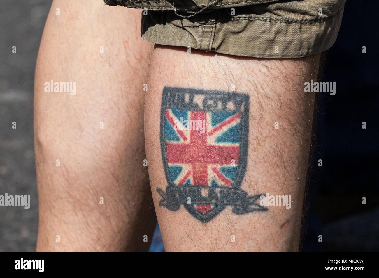 londres, royaume-uni. 6 mai, 2018. un tatouage sur la jambe d'un