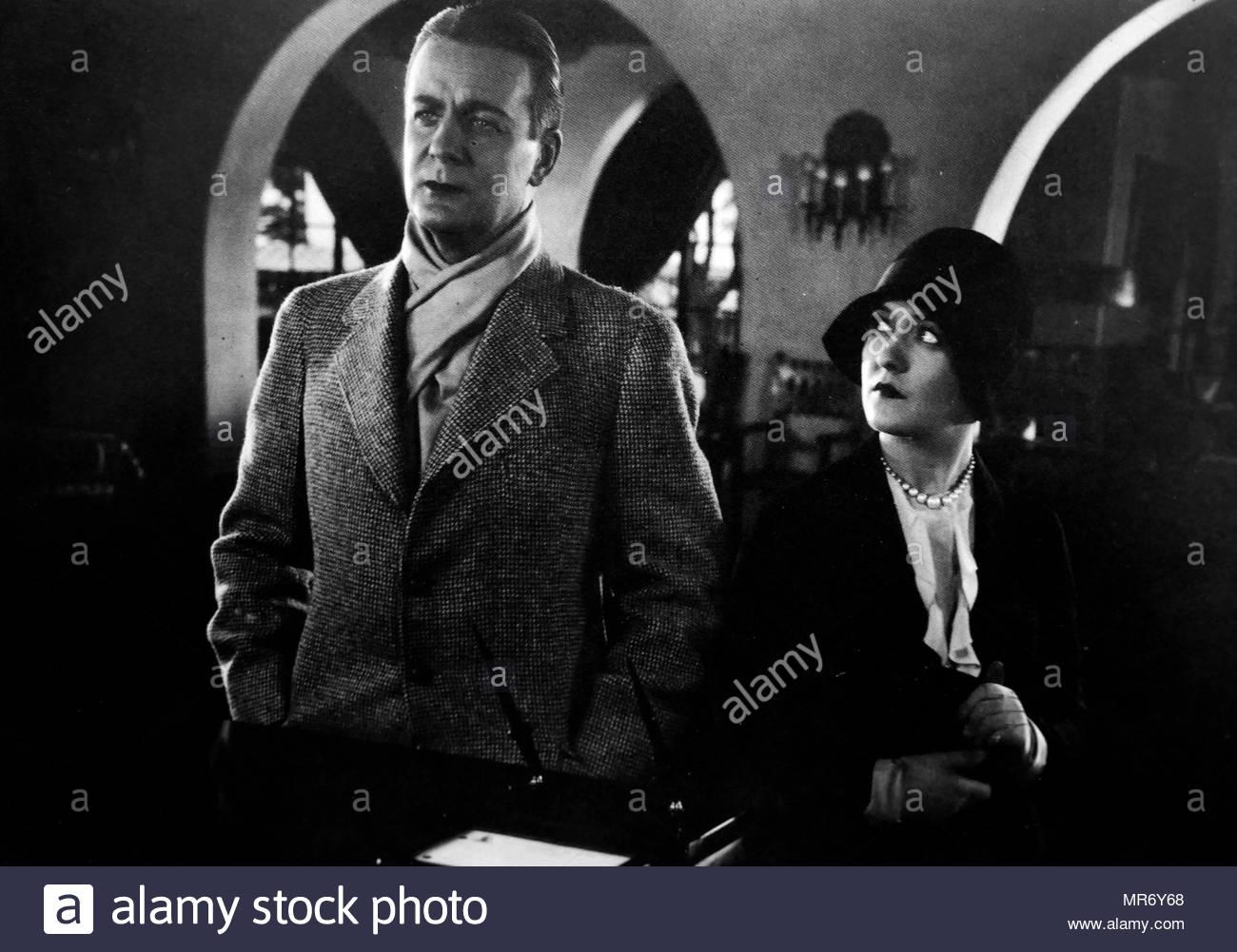 """L'actrice Laura La Plante avec Huntley Gordon dans le film sonore début 1929 """"scandale""""(1929) Photo Stock"""