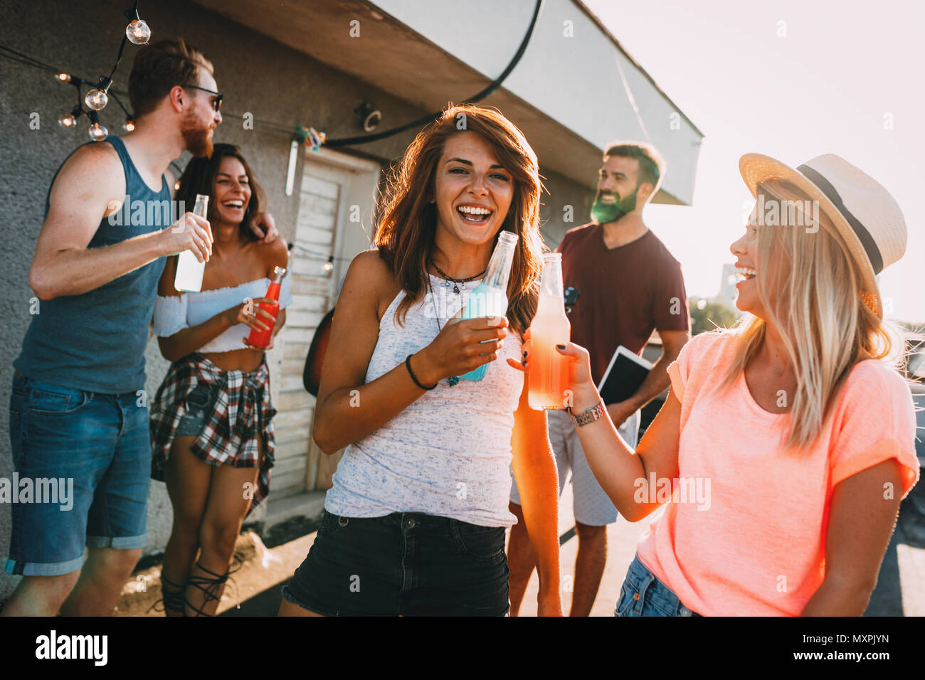 Happy young girls having fun at party Photo Stock
