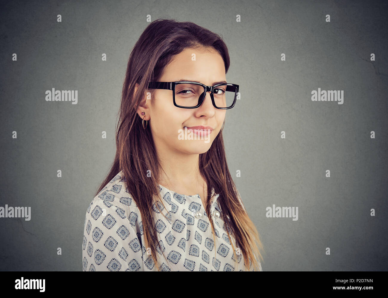 Sly tricky young woman looking at camera. Menteur concept. Photo Stock