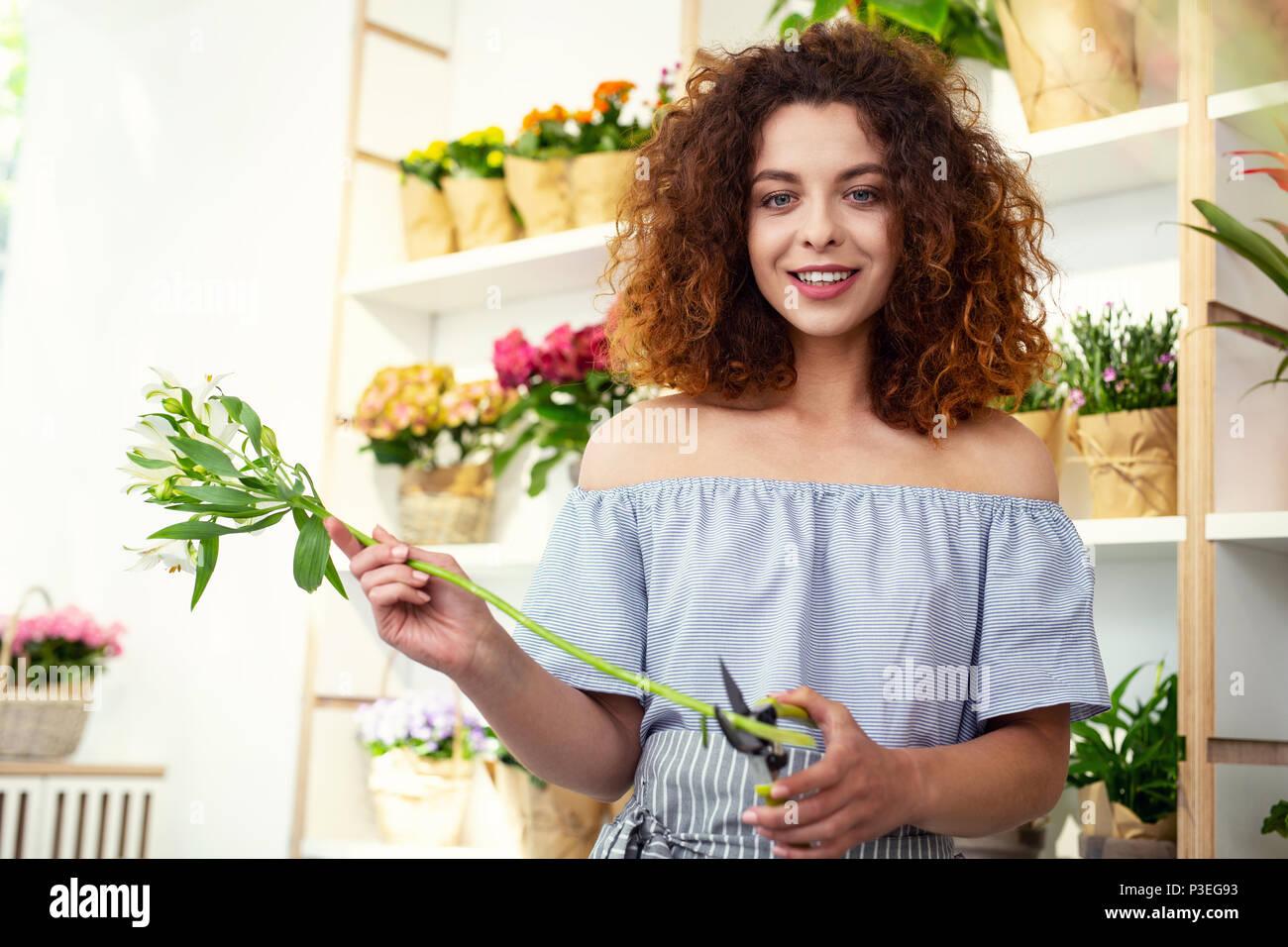 Cheerful nice woman enjoying son travail Photo Stock