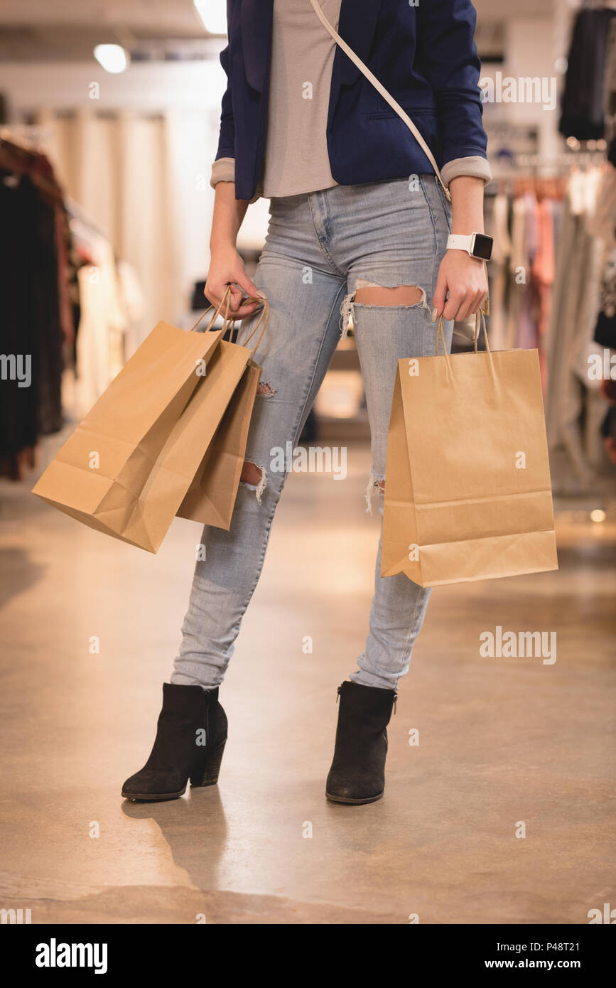 La section basse de woman with shopping bags Photo Stock