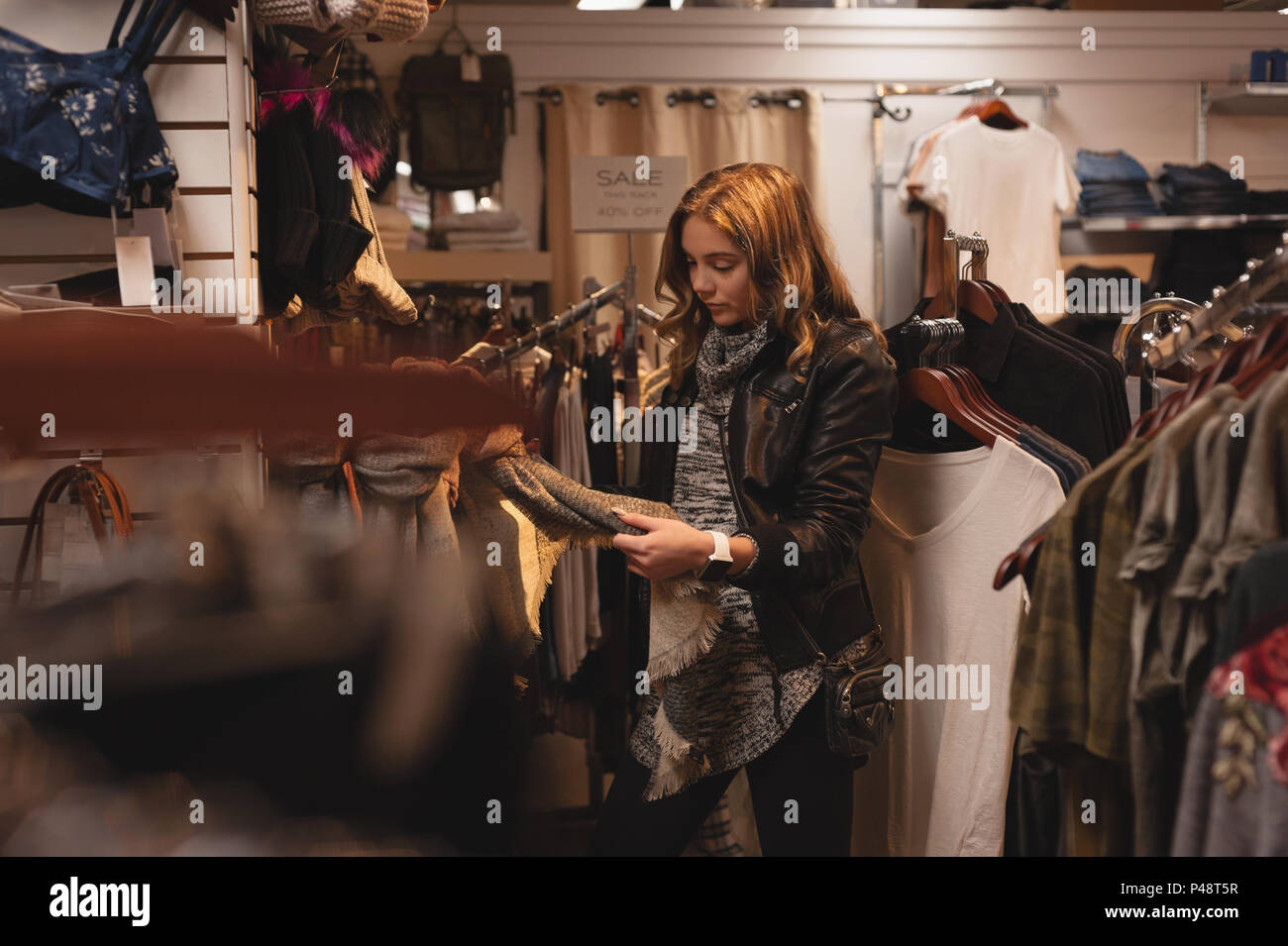Belle woman shopping for clothes Photo Stock