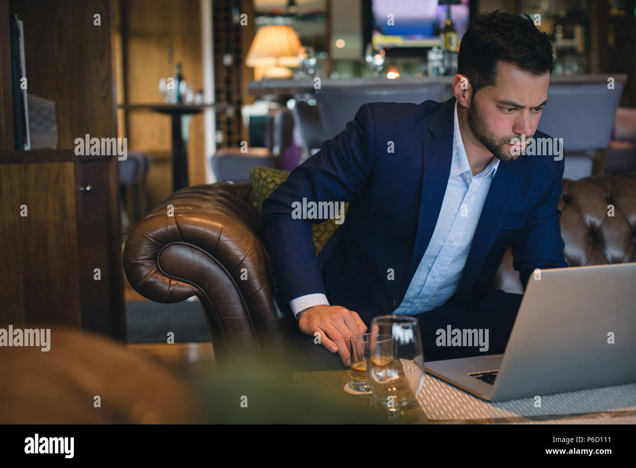 Businessman using laptop Photo Stock