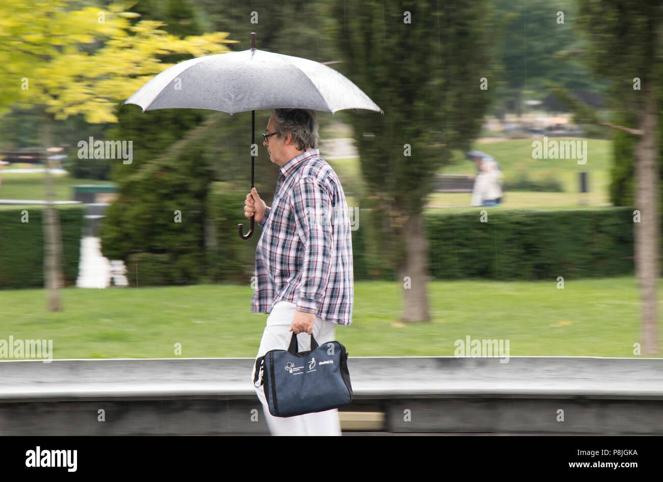 aa1eb069fef7 Man Umbrella Briefcase In Rain Photos   Man Umbrella Briefcase In ...