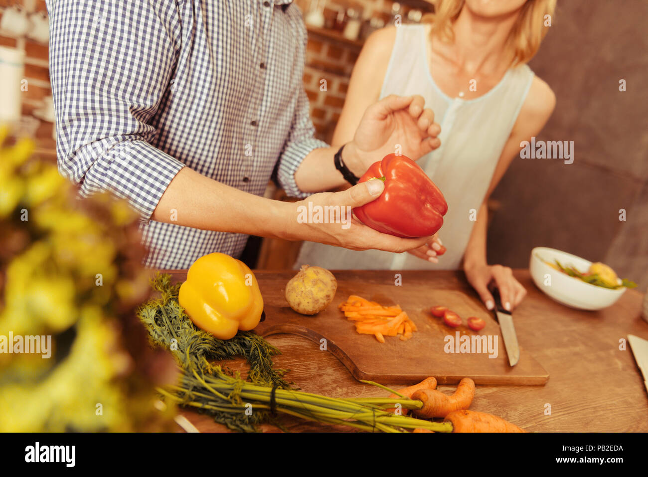 Close up of male hand holding que pepper Photo Stock