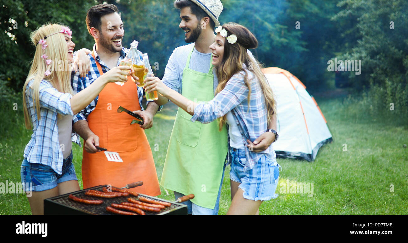 Friends enjoying bbq party Photo Stock