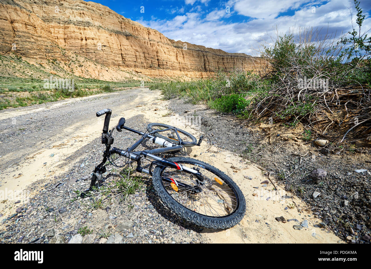 Black mountain bike à country road in the desert canyon. Extreme Sport Concept. Photo Stock