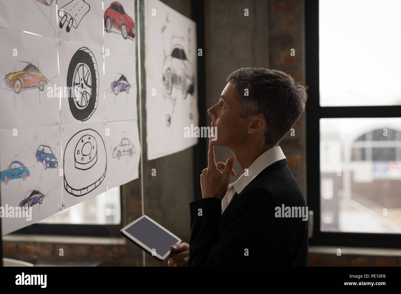 Businesswoman looking at chart Photo Stock