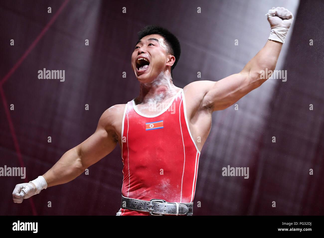 Jakarta, Indonésie. Août 23, 2018. Choe Jon Wi de la République populaire démocratique de Corée réagit lors de l'haltérophilie Hommes 77kg lors de la 18e Jeux asiatiques à Jakarta, Indonésie, le 23 août, 2018. Credit: Cheong Kam Ka/Xinhua/Alamy Live News Photo Stock