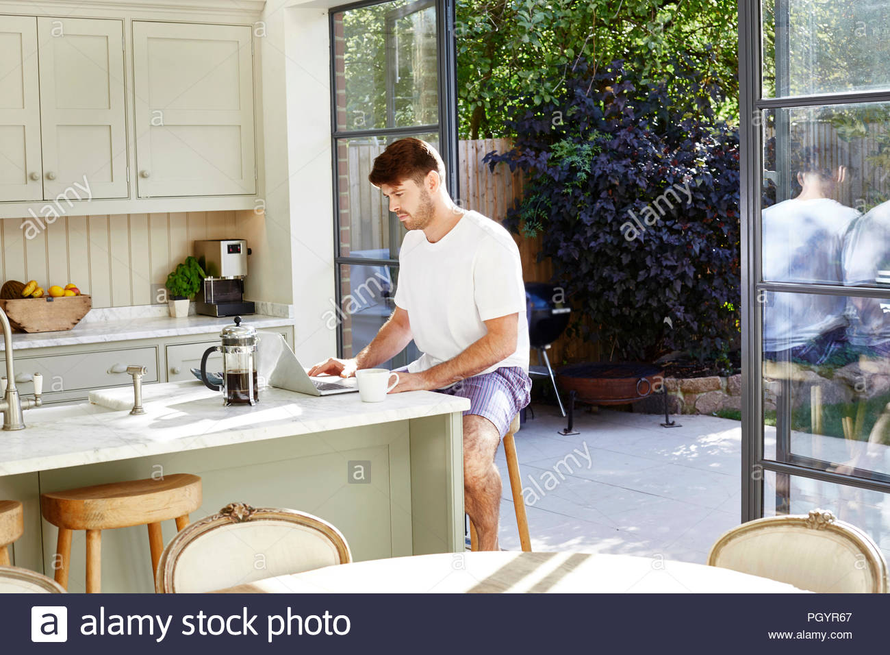Mid adult man using laptop. Photo Stock