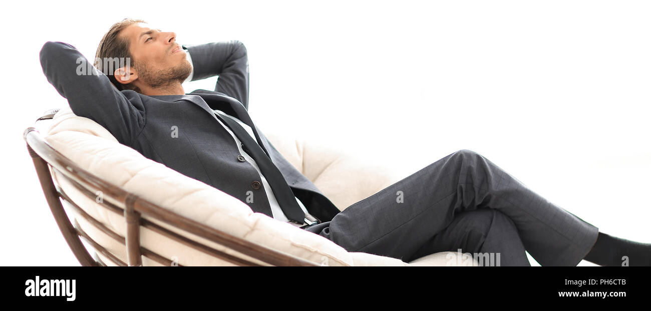 Young businessman sitting in grand fauteuil confortable. Photo Stock