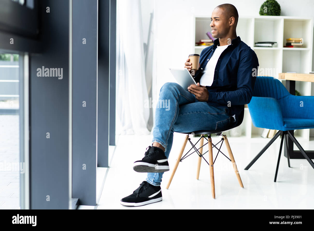 Happy african american entrepreneur using tablet computer. Photo Stock