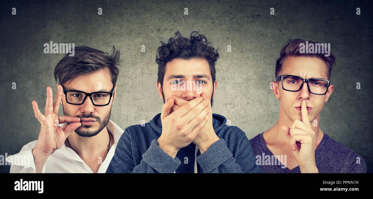 Garder un secret se taire concept. Trois hommes gardant secret bouche fermée. Photo Stock