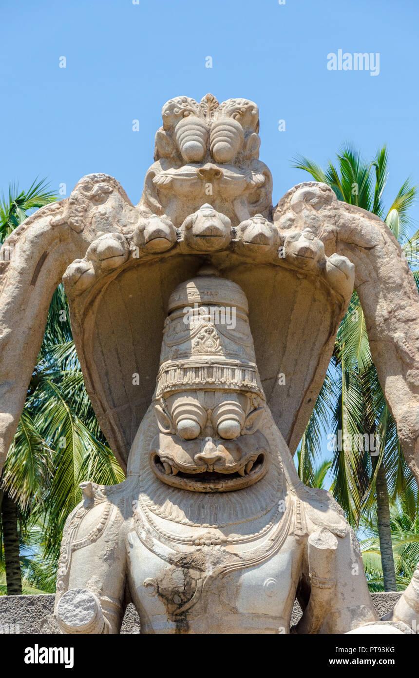 Yoga féroce - monolithe Narasimha, l'homme - lion Avatar de Vishnu Hampi, Karnataka, Inde Banque D'Images