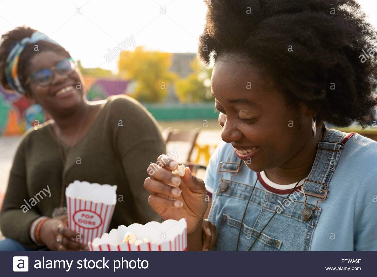 Father eating popcorn Photo Stock