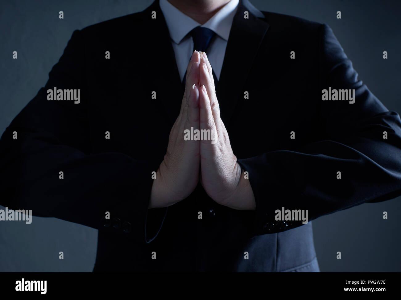 Libre pensée pieuse d'affaires, et priant concept . Banque D'Images