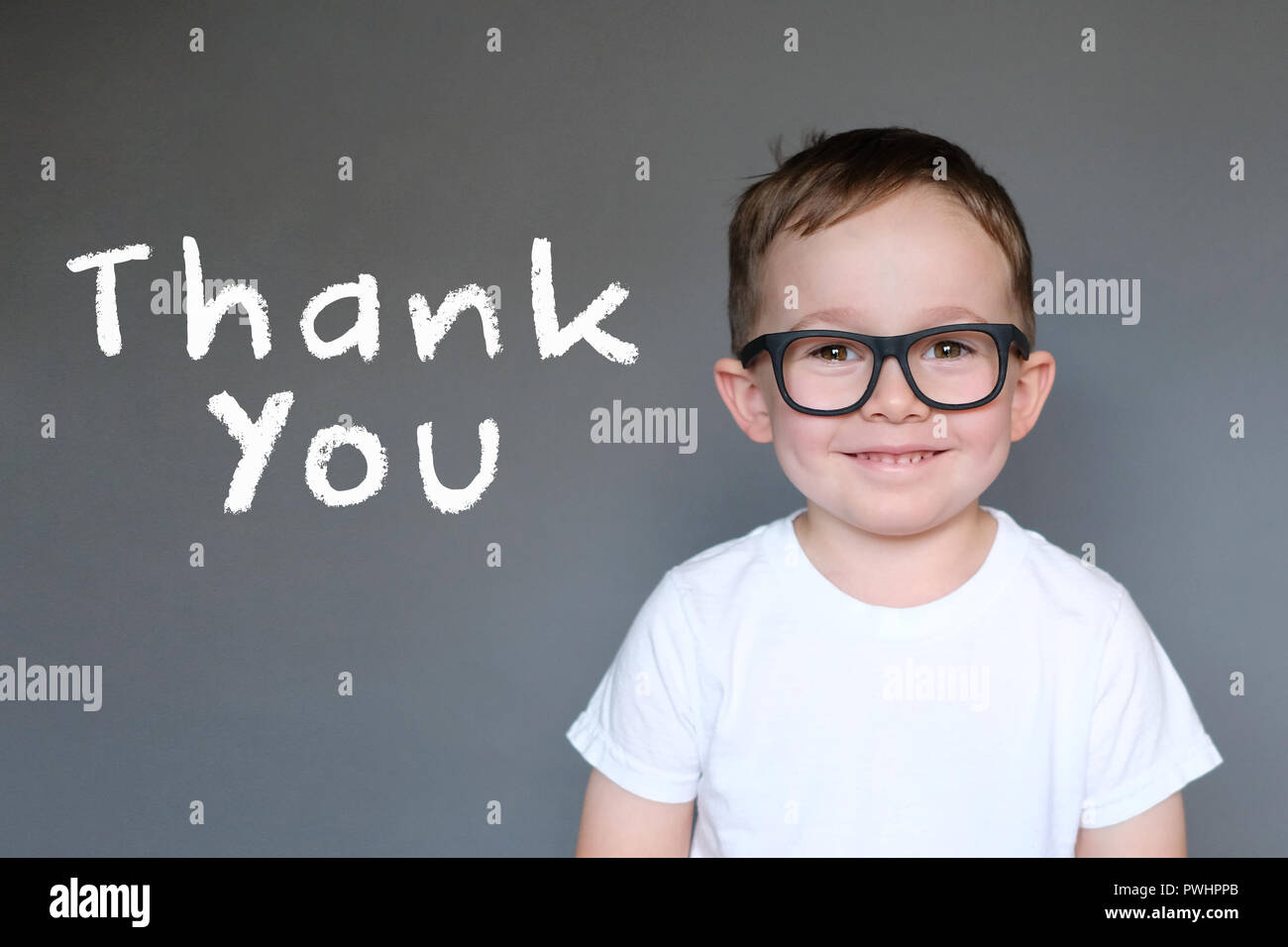 Cute Kid avec un message de remerciement Photo Stock