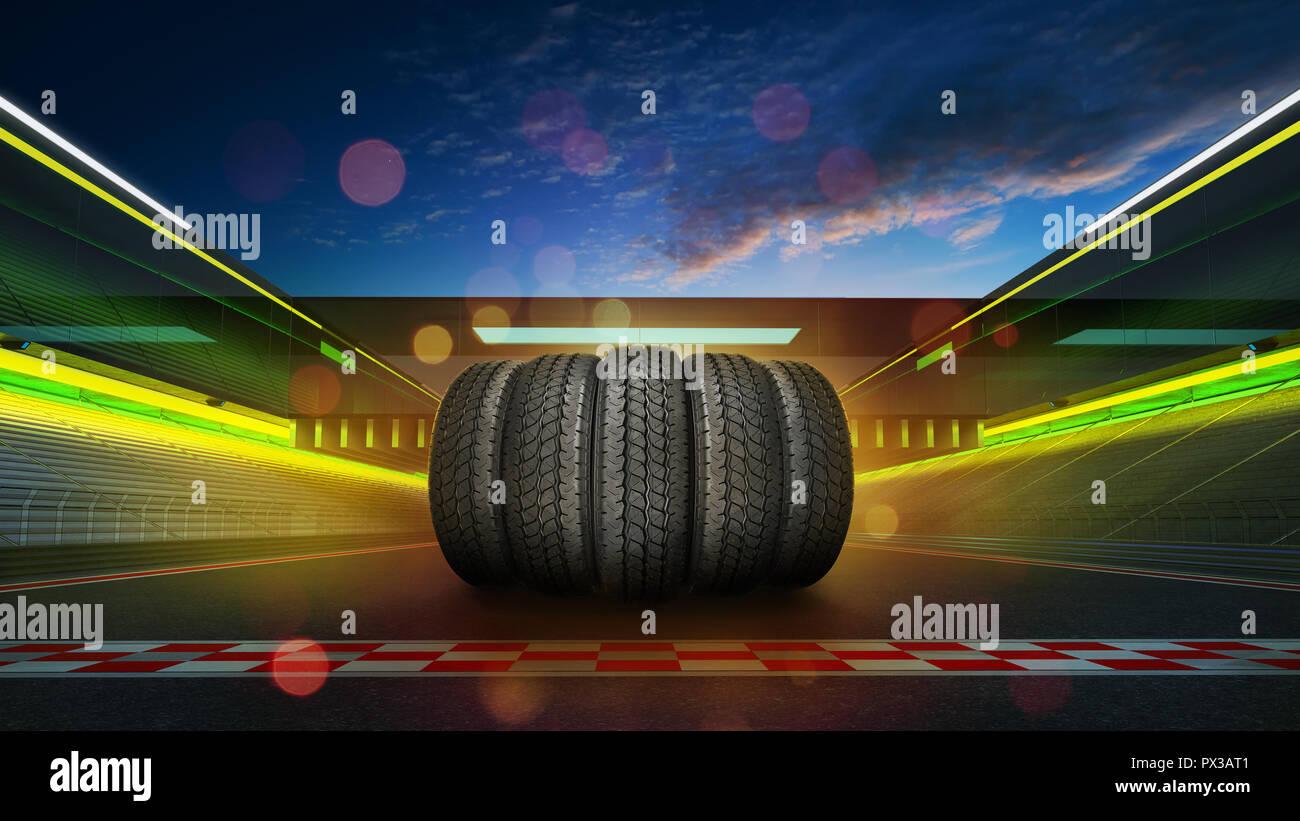 Les pneus de voiture pile sur une piste de course internationale avec départ et d'arrivée, scène du soir Banque D'Images
