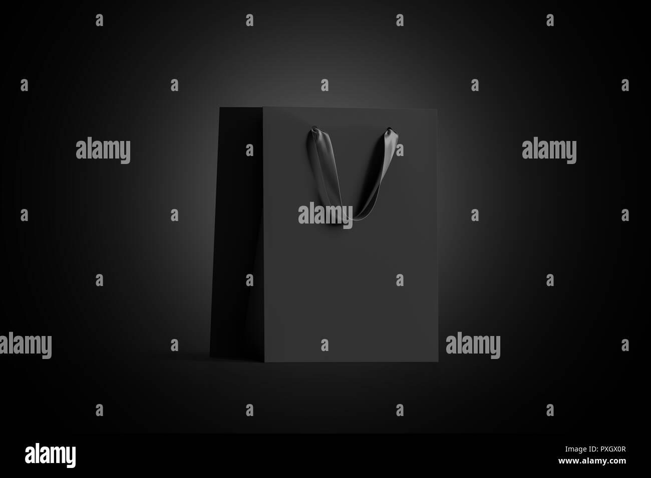 314011f2b5c4 Sac cadeau papier vide noir avec poignée en soie maquette, isolé dans  l obscurité