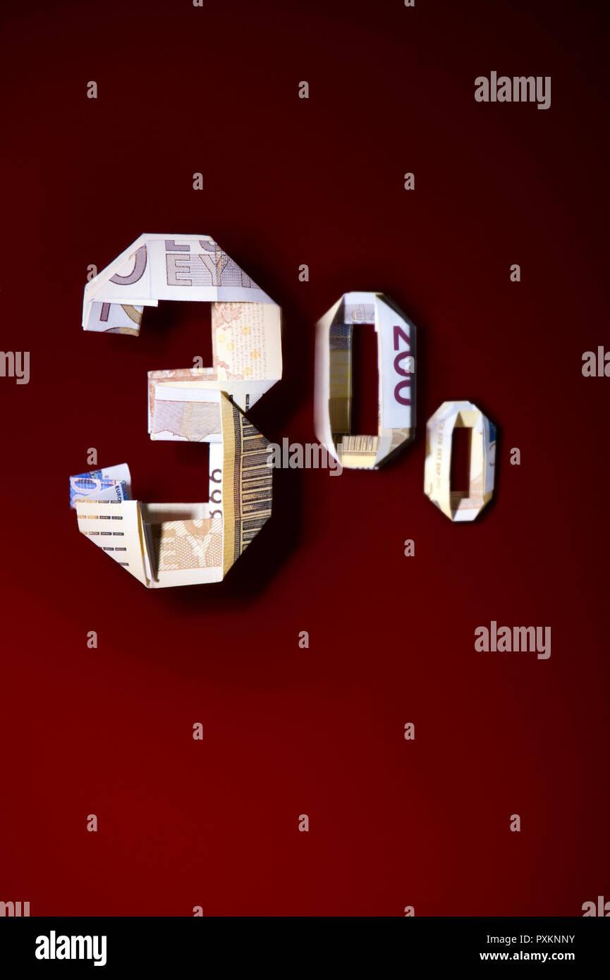 Trois cents euros en papier plié Banque D'Images