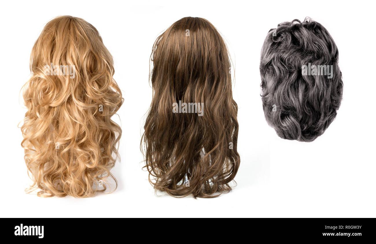 Blonde frisée longue ,noir et brun perruques cheveux isolé sur fond blanc Photo Stock