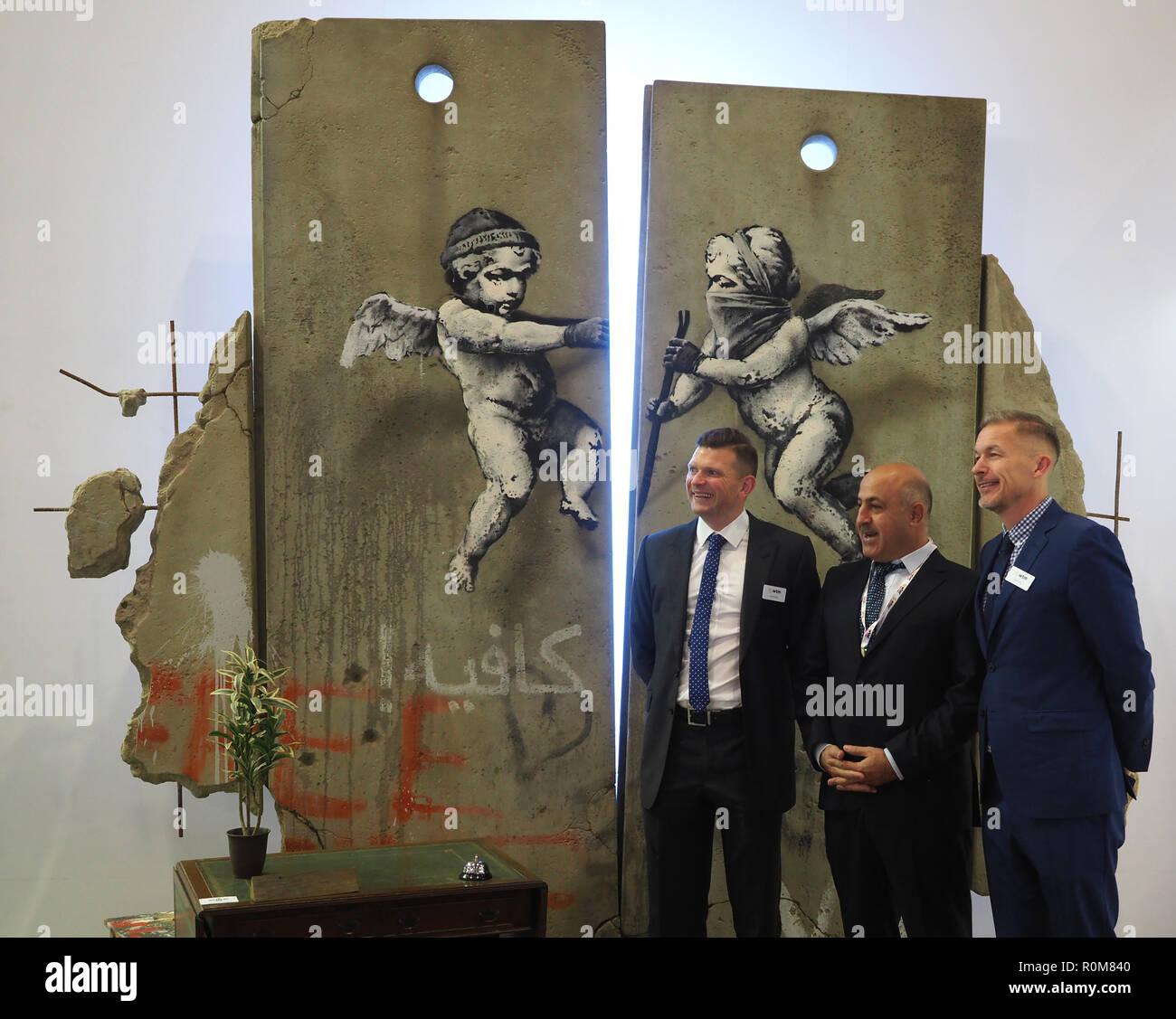 Excel, Londres, Royaume-Uni. 5 Nov 2018. Réplique de Banksy art sur la Palestine se tenir au World Travel Market, Excel, Londres, aujourd'hui (Lun): Crédit Finnbarr Webster/Alamy Live News Banque D'Images