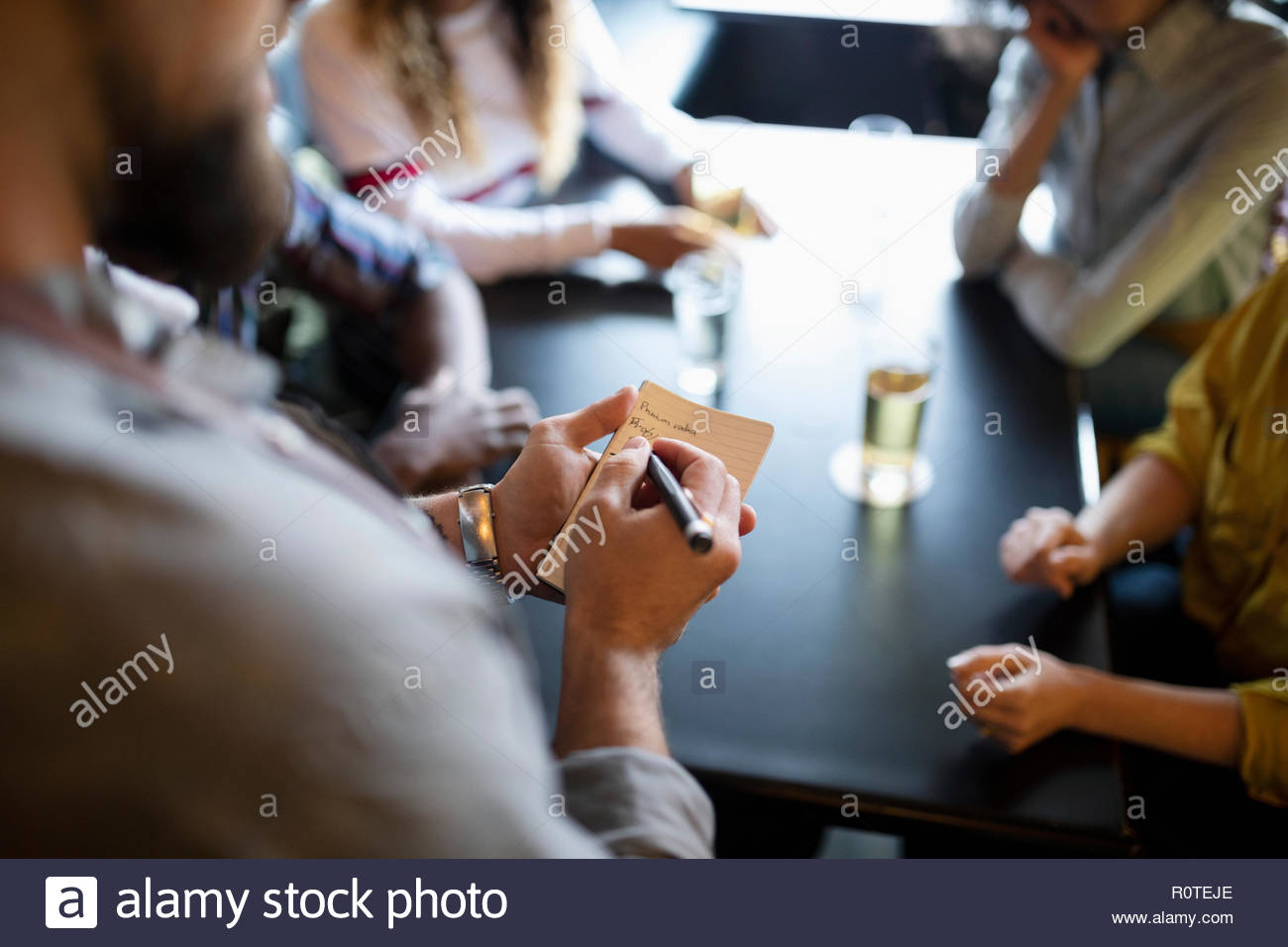 Waiter taking order in bar Photo Stock