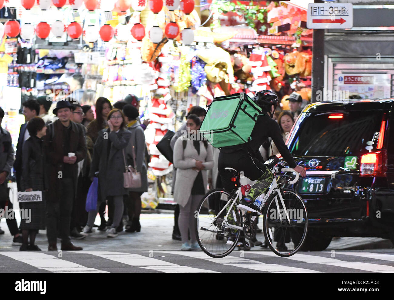 tokyo delivery bike photos & tokyo delivery bike images - alamy