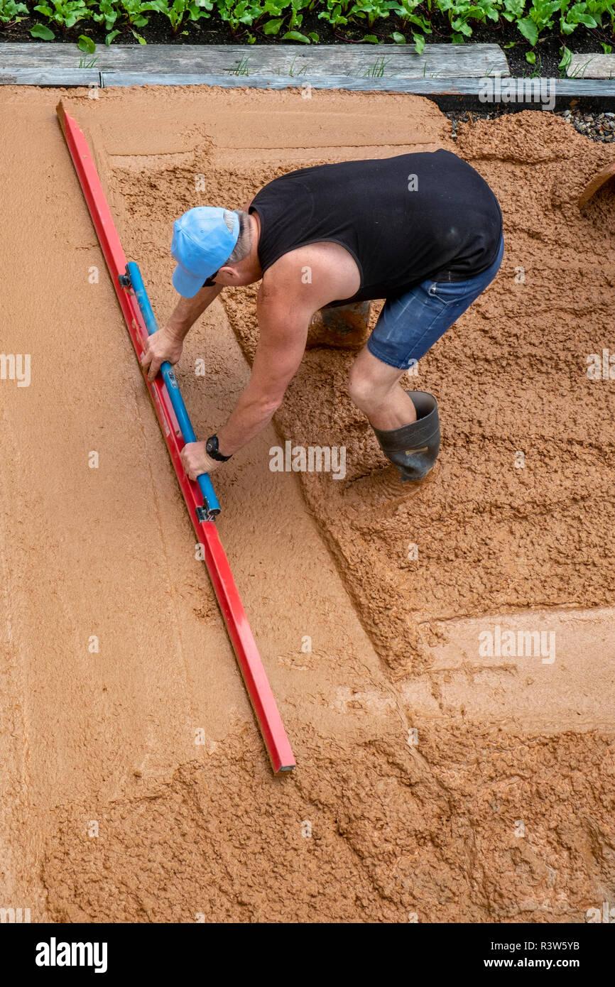 Concretor dalle de béton fraîchement coulé de mise à niveau Banque D'Images