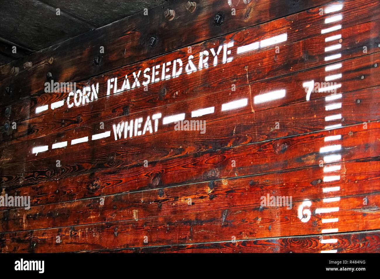 Indicateurs de hauteur pour divers grains dans une vieille voiture à grain Photo Stock