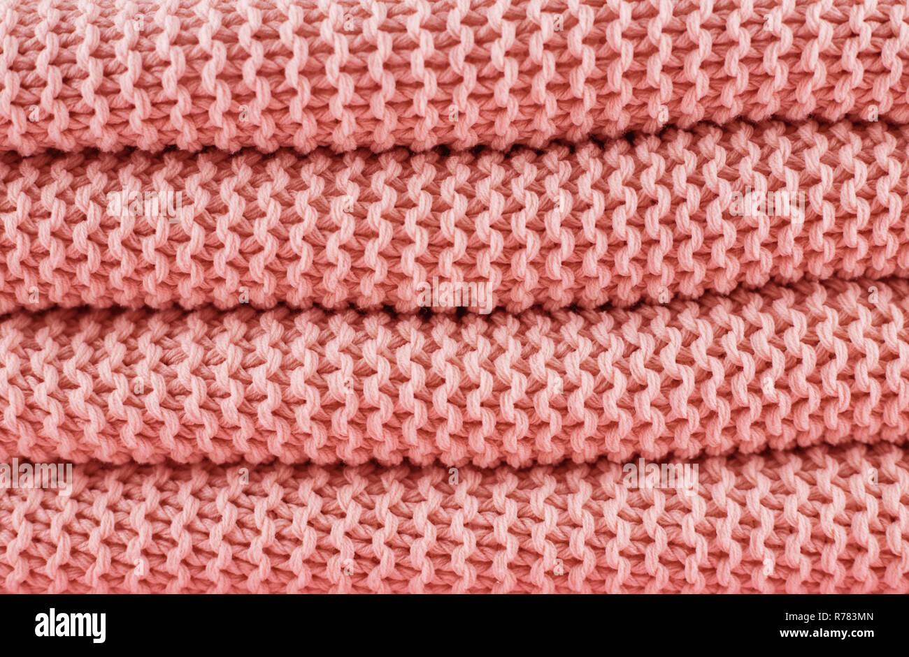 La texture en tricot couleur corail vivant de 2019. Photo Stock
