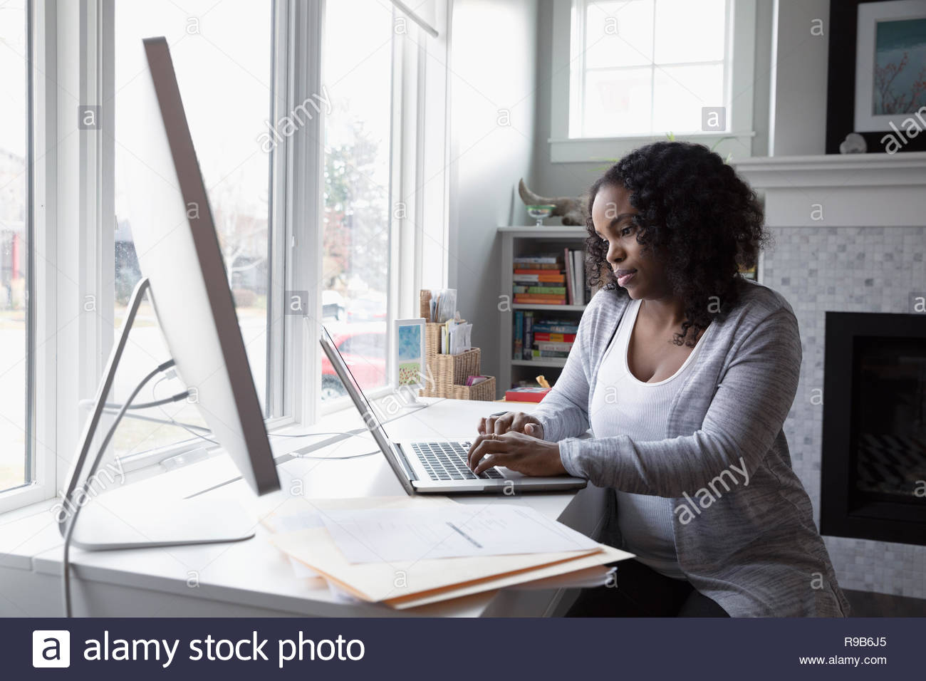 Woman working at laptop in office Photo Stock