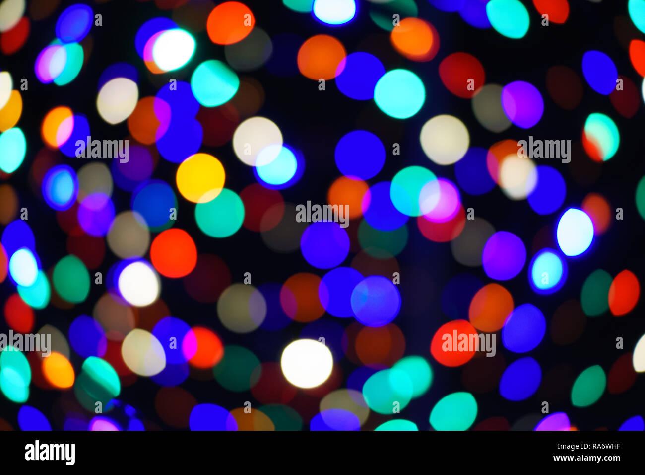 Les cercles de lumière, flou, arc-en-ciel, lumières de Noël, fond sombre Photo Stock