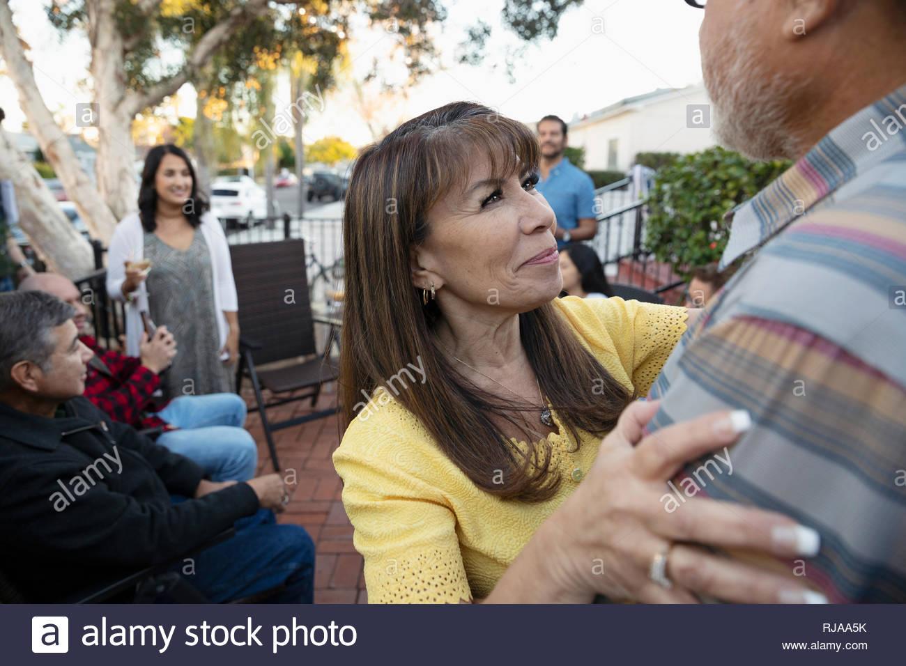 Heureux mari Latinx woman hugging on patio Photo Stock