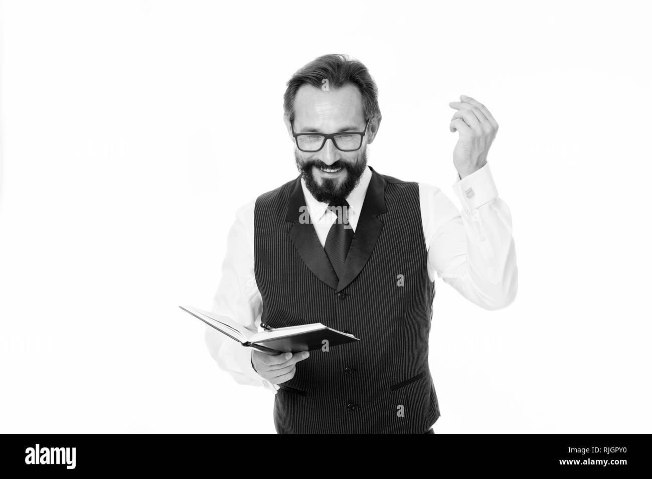 Homme d'affaires prospère de motivation créer un discours inspirant blanc isolé. La planification d'affaires calendrier d'activité avec le bloc-notes. La littérature de motivation concept. Barbu homme manager créer un plan. Photo Stock