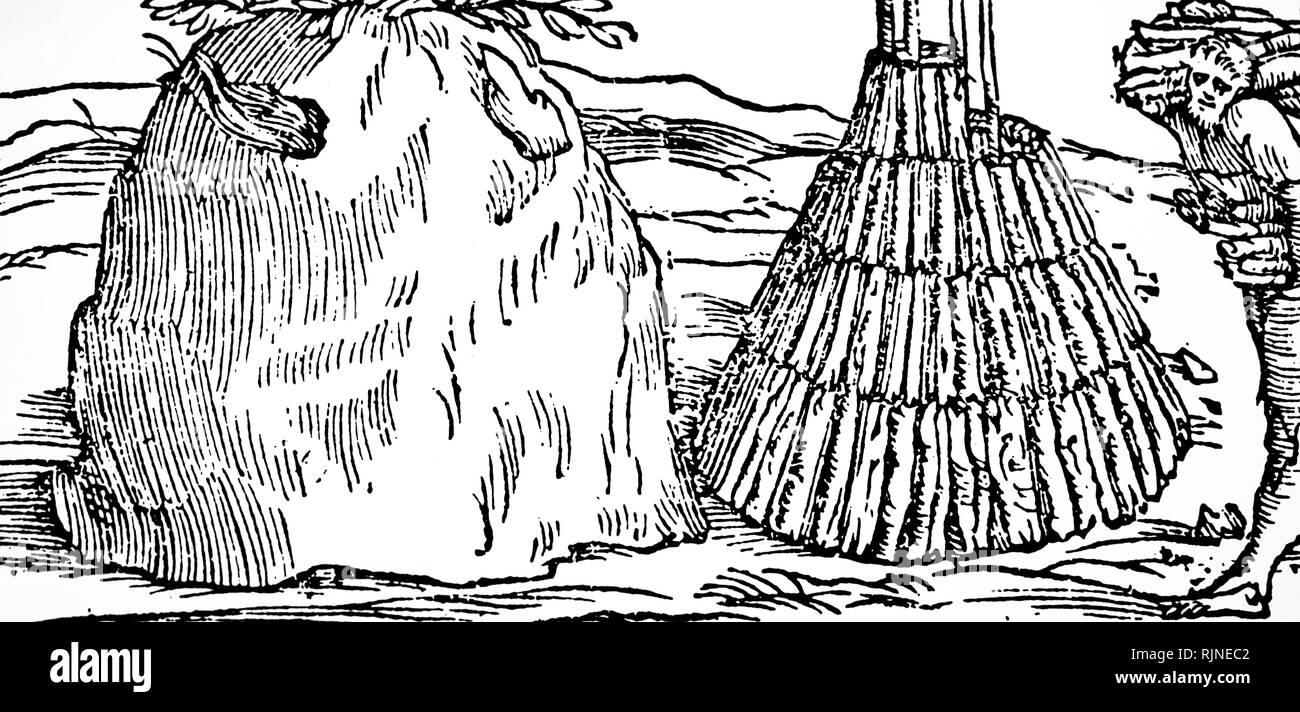 Gravure sur bois représentant la fabrication de charbon de bois: sur la droite de l'image l'homme est maintenant en place une pyramide de bois couvertes de fougères et de la terre, et puis lentement brûlées (à gauche). Photo Stock