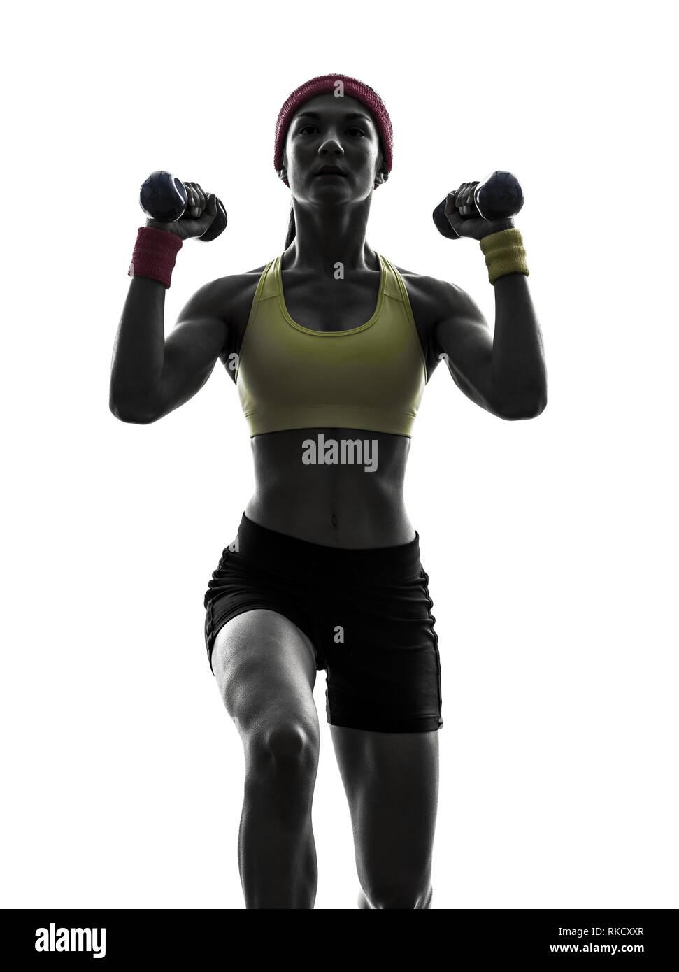 Une femme l'exercice de formation de poids d'entraînement de forme physique en silhouette sur fond blanc Photo Stock