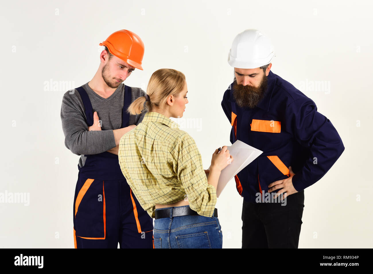 Nous construisons la certitude. L'équipe de travailleurs de la construction. Groupe de la construction ingénieurs et architectes au travail. Hommes et femmes bâtisseurs de travailler en équipe Photo Stock