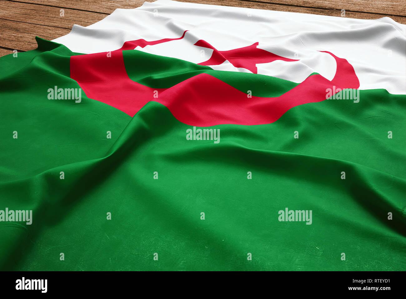 Pavillon de lalgérie sur un bureau en bois. drapeau algérien soie