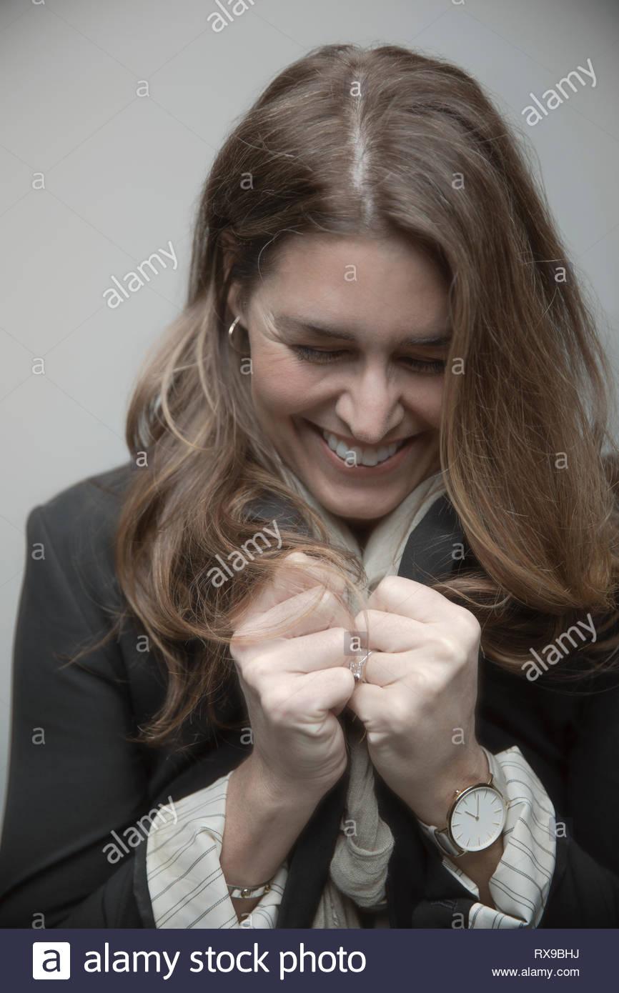 Portrait confiant belle brunette woman laughing Photo Stock