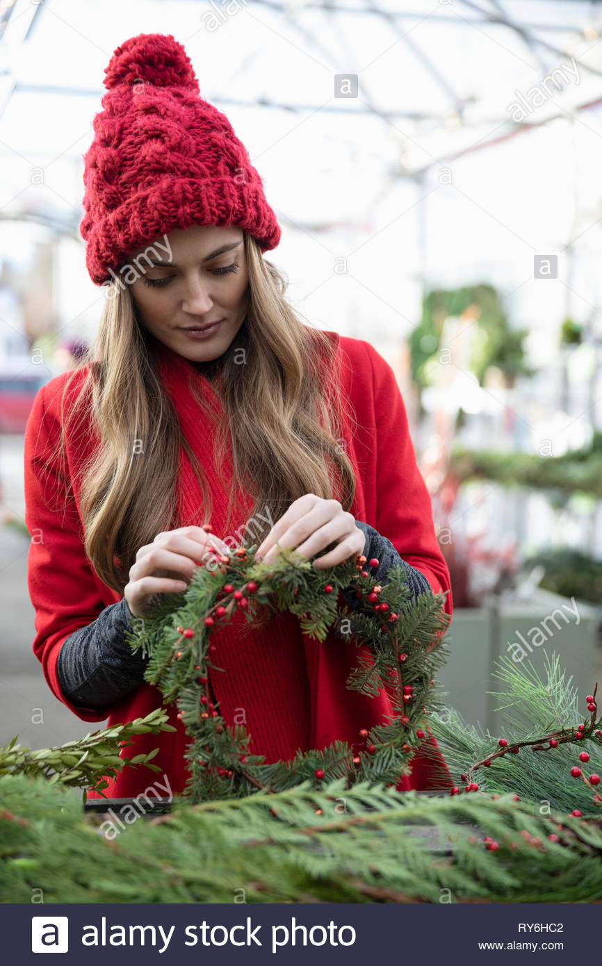 Woman making christmas wreath Photo Stock
