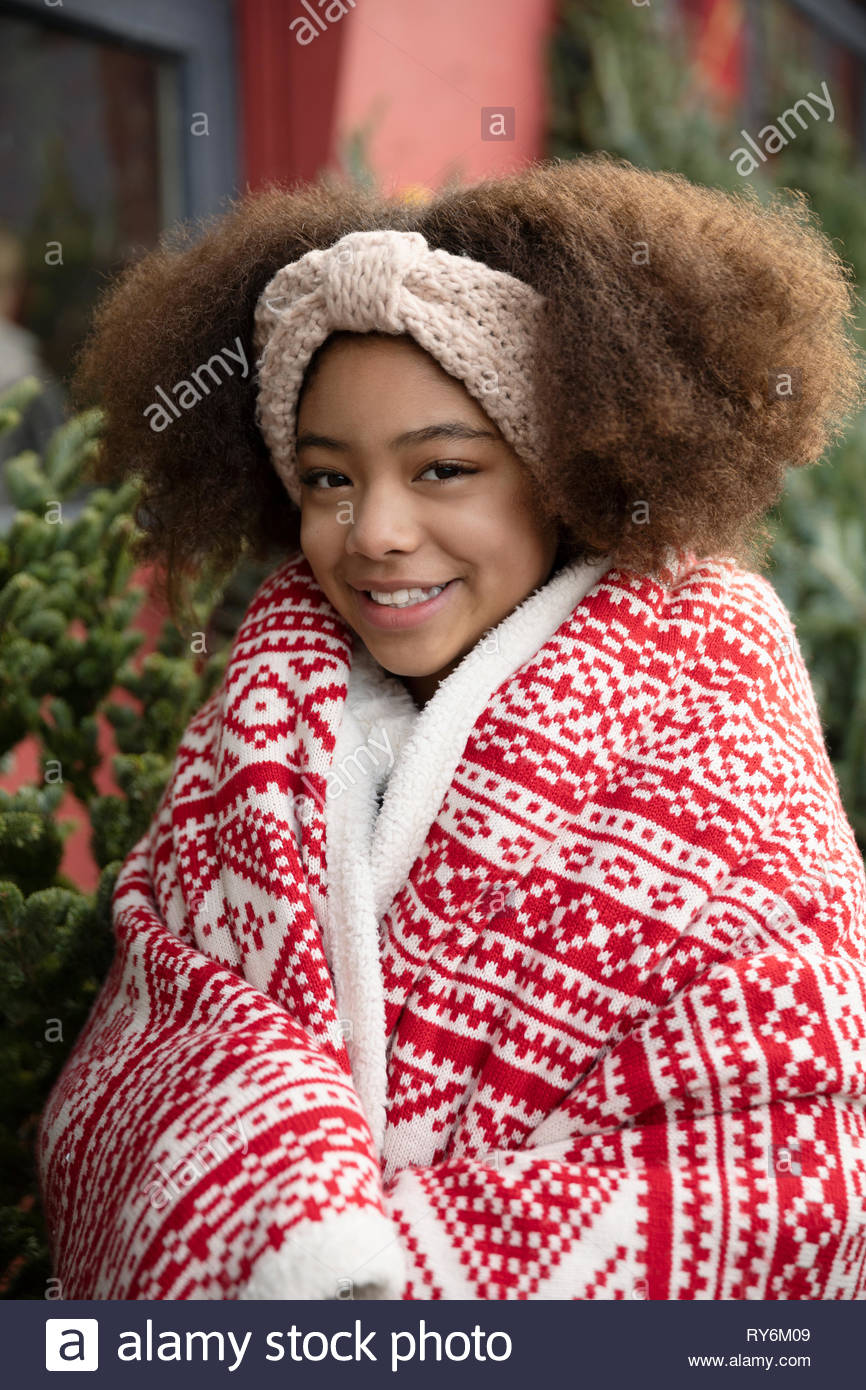 Portrait of smiling girl wrapped in blanket Photo Stock