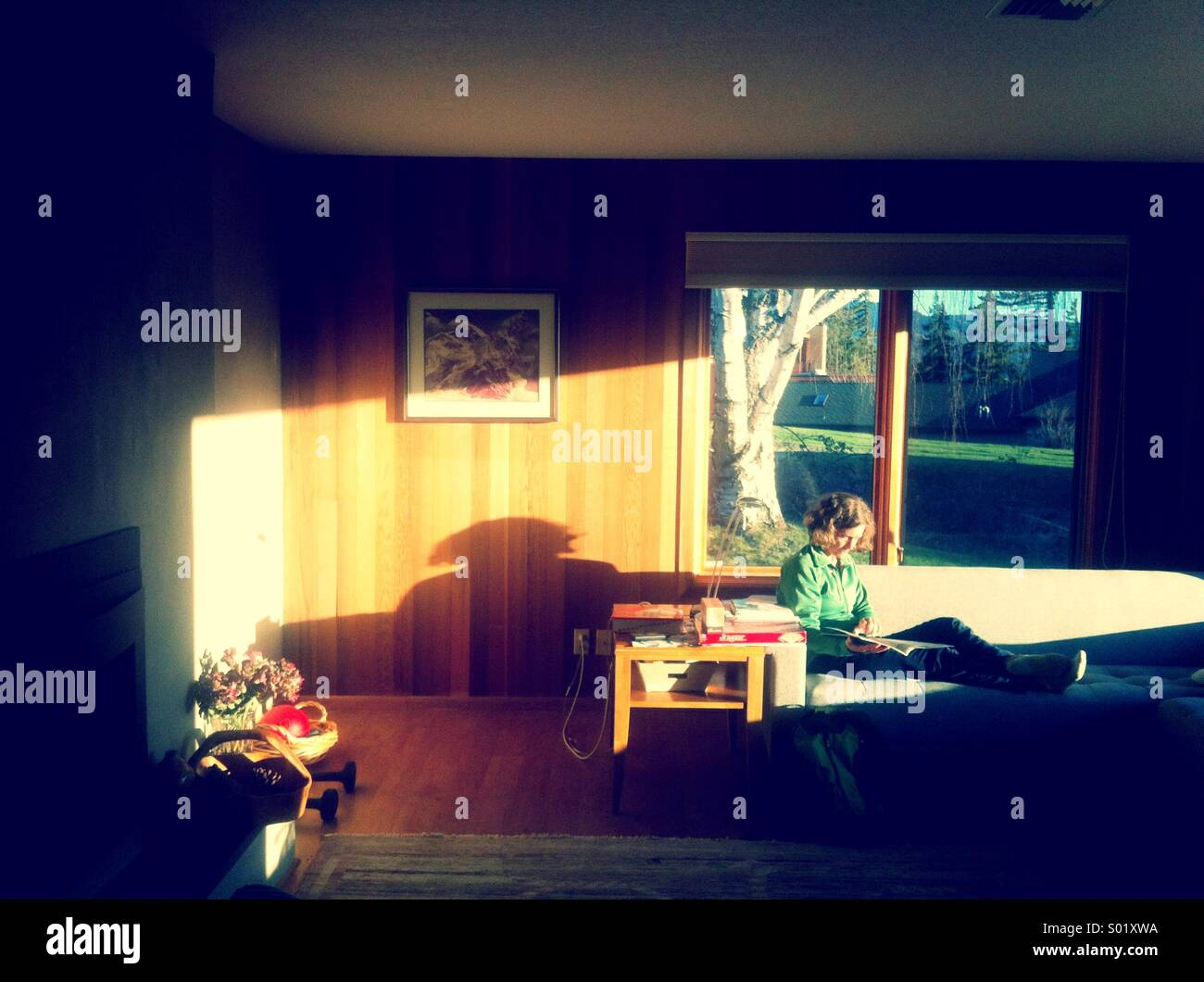 Woman reading on couch Photo Stock