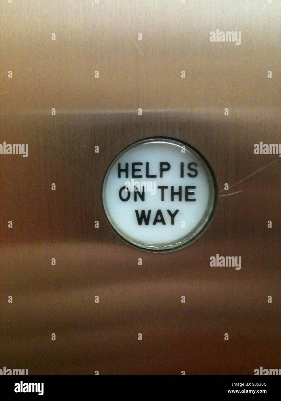 Bouton Aide dans un ascenseur Photo Stock