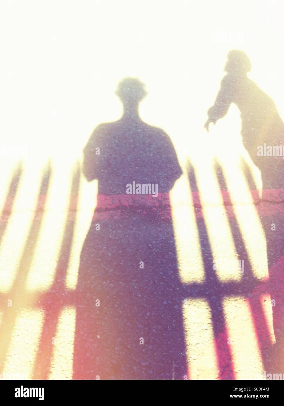 Les ombres de deux personnes Banque D'Images