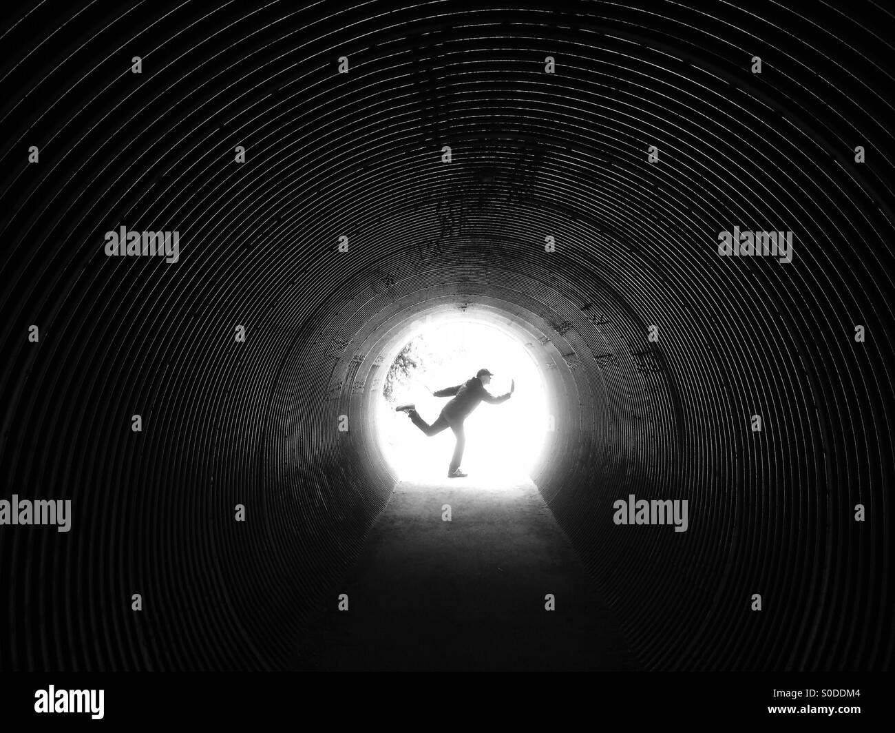 Man posing in tunnel Photo Stock