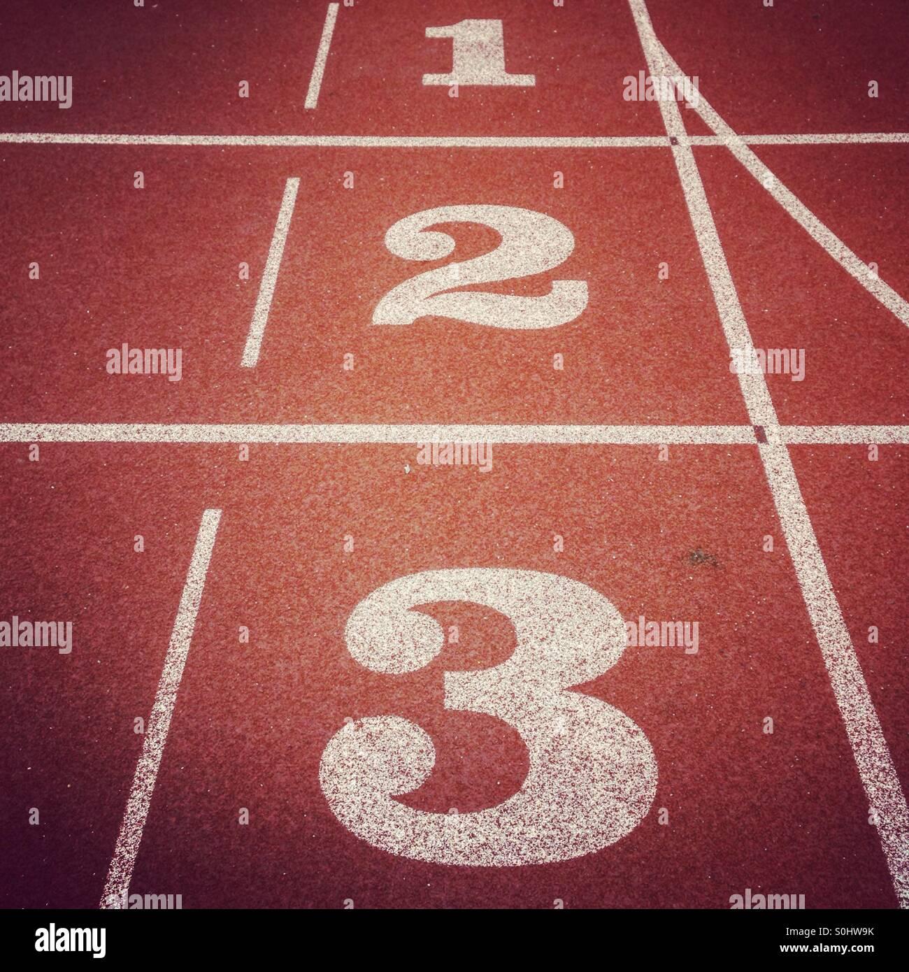 Les numéros de piste d'athlétisme Photo Stock
